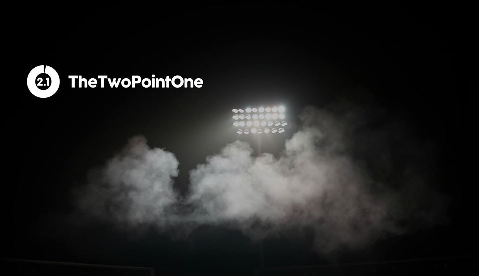 'TheTwoPointOne' (2.1) logo displayed next to a floodlight.