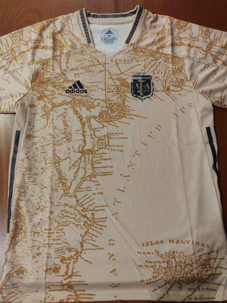 An Argentina concept Football shirt depicting the map of Argentina in a gold/cooper tone. The shirt celebrates 200 years of independence.